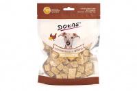 Vynikající pamlsky pro psy – kuřecí kostky s quinou a brokolicí. Pamlsky jsou sušené mrazem pro intenzivní chuť a zachování živin.